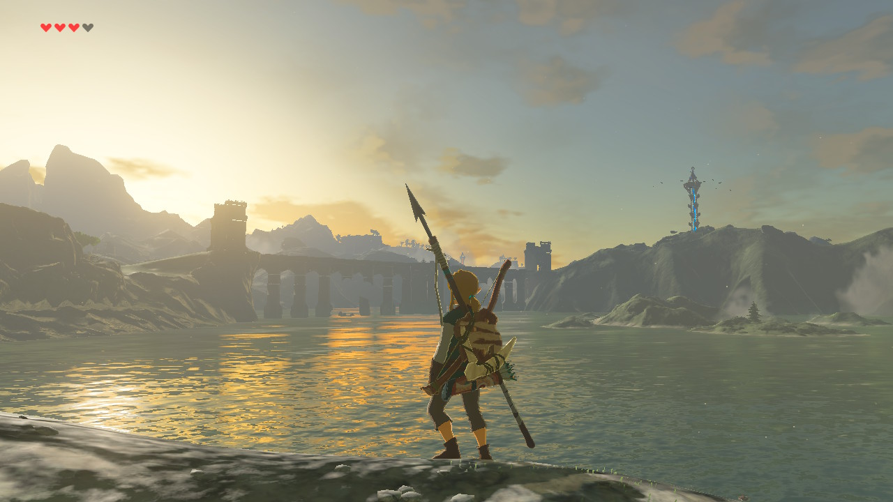 A screenshot of Breath of the Wild, with Link looking out over a sunrise above a bridge over a lake.