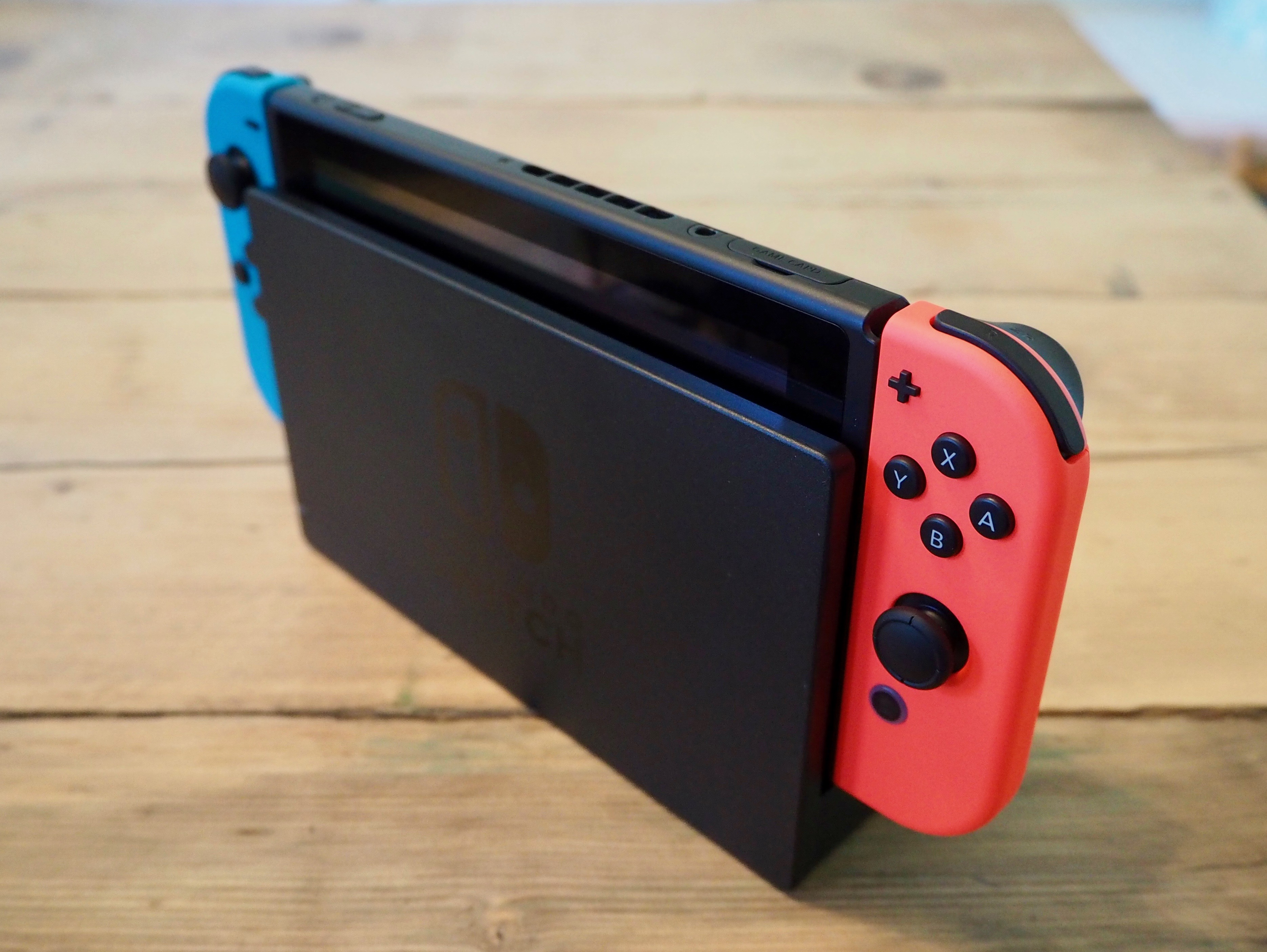 A Nintendo Switch console inserted into the TV dock accessory